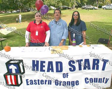 Priscilla Velez, Raymond Cruz and Slyvia Carrero at the Head Start of Eastern Orange County booth.