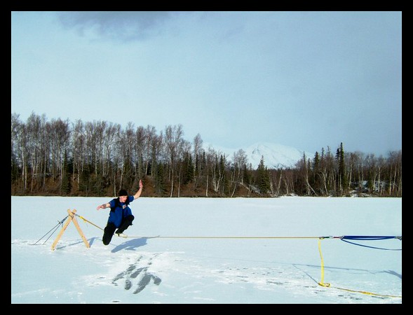 A self portrait taken during a slacklining session on the frozen surface of Memory Lake, Wasilla, Alaska.
