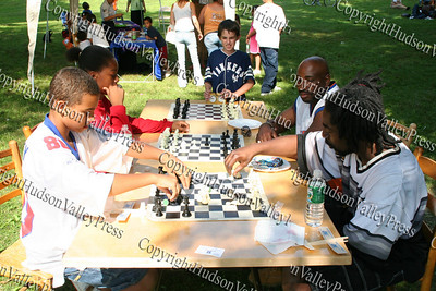 Jonah Cotten, Everett Jackson, Everett Jackson Jr and Otis Moffitte play a game of chess.