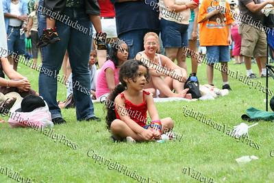 Mekanaa Aviles enjoys the music on the lawn.