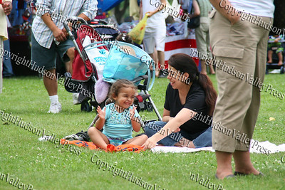 Gabriela and Claudia Diaz enjoy the music on the lawn.