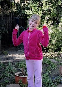Elena goofing around in the garden.
