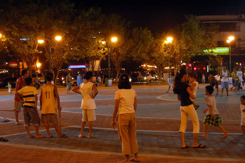 Playing rounders in the square