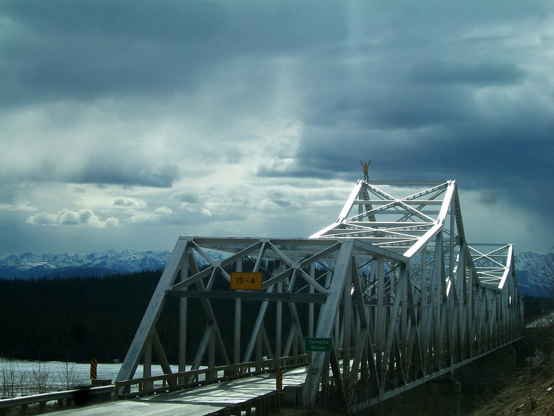"As we crossed the Tanana River on our first day, I mentioned how I always wanted to rig a highline on a bridge like this.  Kelsey looked at me and said ""Well I've always wanted to just climb one.""  So to set the spirit for the road trip, we pulled over and made our way to the top."