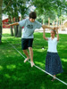 Taylor and K'Lynn, also cousins of mine, try their hand at walking a slackline at the fiargrounds in Helena, Montana.
