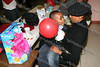 A young child shows his mom what he received at the annual Unity Tree lighting