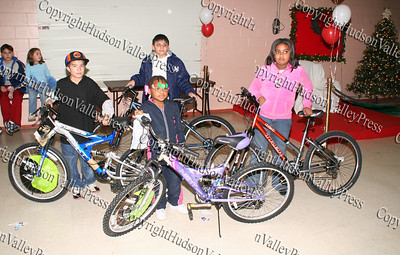 Justin Prado, Diamond Evans, Marcos Rodriguez and Bernedette Wright won bicycles during the annual Unity Tree lighting ceremony at the Newburgh Recreation Center