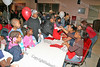 Children make Christmas stocking at the annual Unity Tree lighting ceremony at the Newburgh Recreation Center