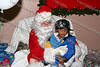 A child has their picture taken with Santa Claus