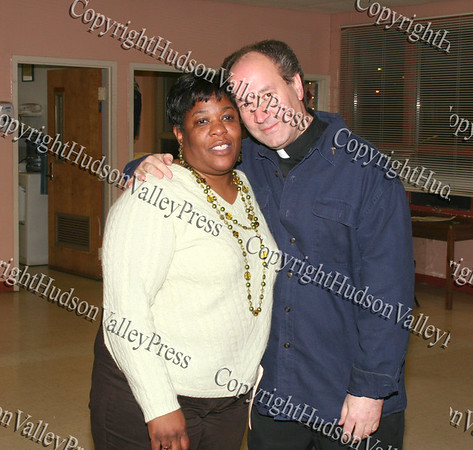 Joy Pittman and Father Bill Scafidi at the Unity Tree Lighting ceremony at the Newburgh Recreation Center