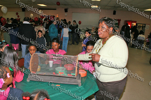 Joy Pittman and helpers collect tickets for the bicycle raffle during the Unity Tree lighting