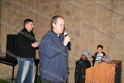 Pastor Manny (background) and Father Bill Scafidi at the Unity Tree lighting