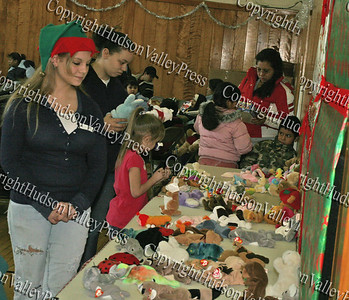 Maria organizes beanie babies for the kids at the annual St Mary's Christmas party