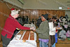 Volunteers hand out snacks during the annual Christmas party at St. Mary's Church in Newburgh
