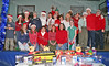Mr and Mrs Claus and joined by St Mary's church members and volunteers for a group photo before the children visit with Santa Claus