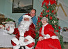 Father Bill Scafidi with Santa and Mrs Claus at the annual St Mary's Christmas party