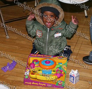 Child enjoys a gift he recieved at the annual Christmas party at St. Mary's Church in Newburgh