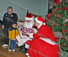 Santa and Mrs Claus pose with children during the annual Christmas party at St Mary's Church in Newburgh
