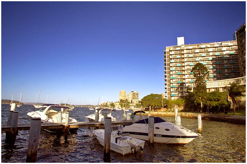 Elizabeth Bay, Monday January 30th 2006. <br /> <br /> The sun casts a golden glow over the harbour in the early evening. <br /> <br /> EXIF DATA <br /> Canon 1D Mk II. EF 17-35mm f/2.8L@17mm 1/125s f/22 ISO 200.
