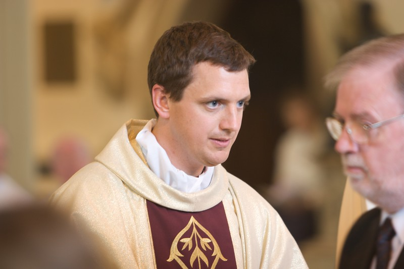 Distributing Communion • John distributing Communion at his Ordination Mass.