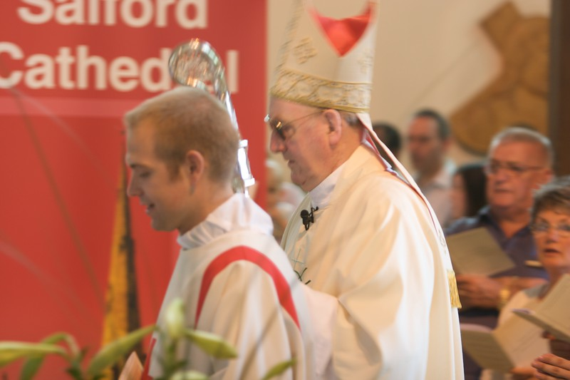 Bishop and Deacon • The Bishop of Salford and one of the two Deacons who assisted at John's Ordination Mass process in to the cathedral.