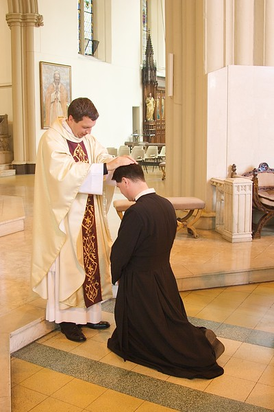 First blessings • John gave his new-priest's blessing after the Ordination Mass.