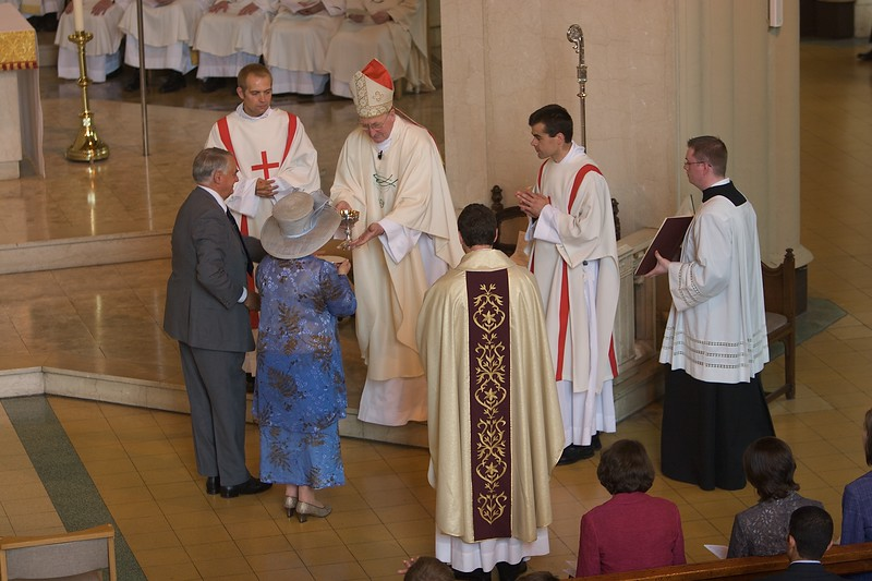 Presentation of the gifts • My parents, representing God's people in his Church, bring forward the Eucharistic gifts—bread on a paten and wine in a chalice—and pass them over the Bishop. They are then formally presented to John, the new priest.