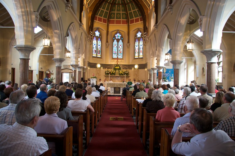 Congregation • The congregation at the first Mass which John said in Rusholme the day after his Ordination.