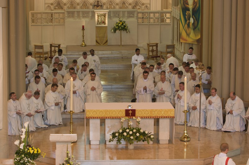 Litany of the Saints • The massed ranks of concelebrating priests kneeling during the Litany of the Saints.