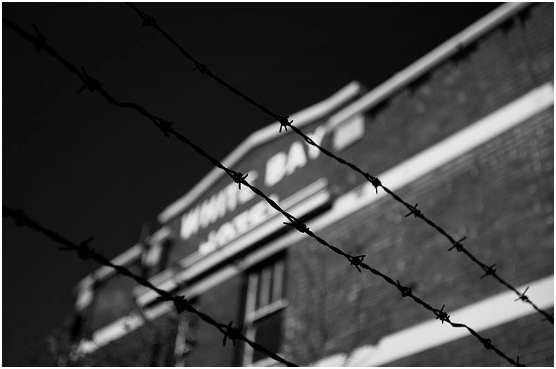 Rozelle, Thursday July 27th 2006. <br /> <br /> Standing behind a barbed wire fence the derelict White Bay Hotel awaits redevelopment. <br /> <br /> <br /> EXIF DATA <br /> Canon 1D Mk II. EF 17-35 f/2.8L@35mm 1/600 f/2.8 ISO 200.