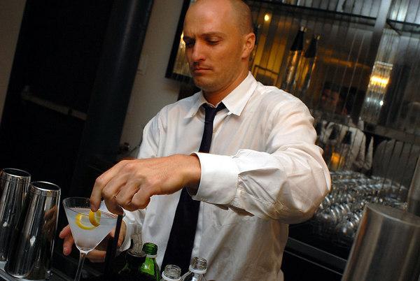 bartender providing finishing touches on Stolichnaya elit vodka martini