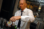 bartender providing finishing touches on Stolichnaya elit vodka martini