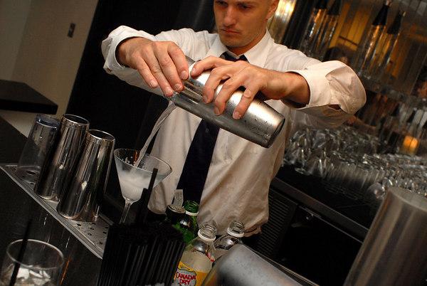 bartender serving Stolichnaya elit vodka martini