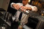 bartender serving Stolichnaya elit vodka martini