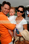 Jason Binn holding Penny Binn and wife Haley Binn