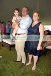Reza Raein holding Cyrus Raein and Marjorie Gubelmann Raein