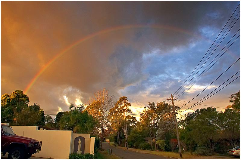 Sydney, Thursday June 1st 2006. <br /> <br /> It's officially the first day of winter. A brief rain shower just before sunset resulted in this rainbow and a beautifully coloured sky seen from my front garden. <br /> <br /> <br /> EXIF DATA <br /> Canon 1D Mk II. EF 17-35 f/2.8L@35mm 1/60s f/10 ISO 400.