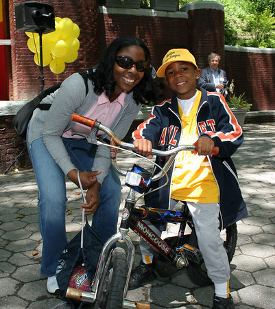 Harlem Little Leaguer with his mom enjoying the renovated park