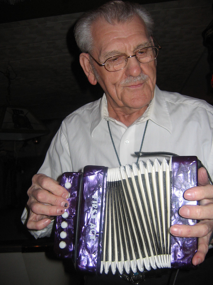 The co-owner breaks out his toy accordion.