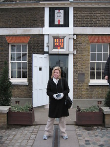Sarah on the Prime Meridian, at Zero Longitude.  Her right foot is in the Eastern Hemisphere, and her left foot is in the Western Hemisphere.