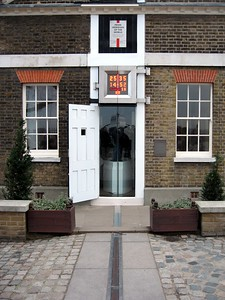 The Prime Meridian, at Zero Longitude, separating the Eastern Hemisphere (to the left) from the Western Hemisphere (to the right)