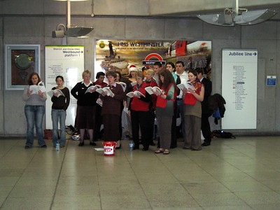 Christmas carolers in the Westminster Tube Station