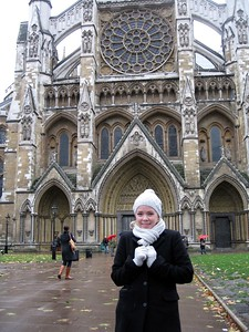 Sarah in front of the Collegiate Church of St Peter, Westminster (a.k.a. Westminster Abbey)