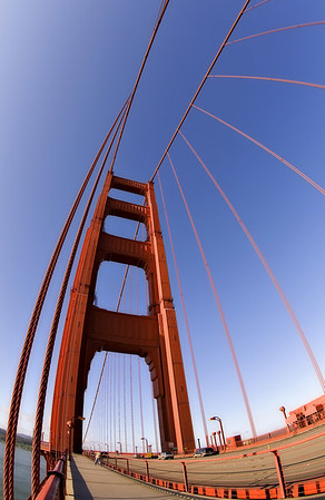 The fisheye lens gives a unique perspective to the familiar towers of the Golden Gate Bridge.