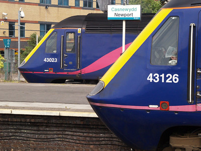 HSTs 43023 to Paddington and 43126 to Swansea cross at Newport.