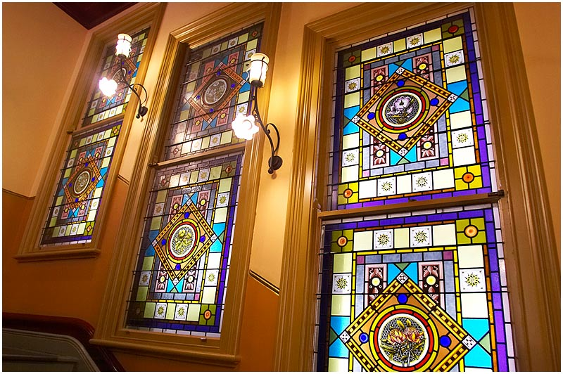 """The Strand Arcade, Pitt St., Thursday November 2nd 2006.   The Strand Arcade is a Victorian shopping arcade built in 1891. It has many delightful period features such as these stained glass windows. As an interesting segue, a fellow Sydney photoblogger has posted a photo essay on master stained glass artist Kevin Little <a href=""""http://sydneydailyphotoextra.blogspot.com/2006/11/kevin-little-stainedglass-artist.html"""" target=""""_blank""""><strong><em>here</em></strong></a>.  EXIF DATA  Canon 1D Mk II. EF 17-35 f/2.8L@17mm 1/13s f/2.8 ISO 1250."""