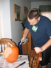 "Dustin getting ready to ""decorate"" a pumpkin"