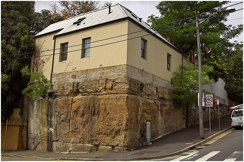 "Liverpool Street, Darlinghurst, Wednesday October 25th 2006.   As a child I used to entertain fantasies of digging a tunnel under the house and coming out in China or Brazil. I wouldn't get far with this house sitting as it does on a block of sandstone.  Sandstone is everywhere in the natural environment around Sydney and many of it's buildings were built using it. How it came to be laid down hundreds of millions of years ago is a fascinating story and you can read it <a href=""http://www.smh.com.au/news/national/city-built-on-the-blocks-of-life/2006/10/23/1161455665723.html""target=""_blank""><strong><em>here</em></strong></a>.     EXIF DATA  Canon 1D Mk II. EF 17-35 f/2.8L@29mm 1/200s f/10 ISO 200."