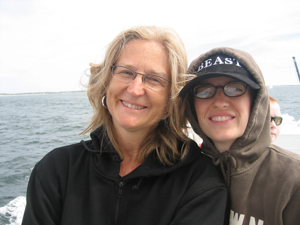 "Mom and Jor on the boat.  BEFORE Jordan lost her ""BEAST"" hat overboard in the wind."