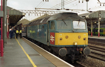 47853 'Rail Express' calls at Crewe with an additional 1Z47 0805 Manchester-Cardiff. Arriva Trains Wales had laid on extra trains to assist with moving some of the thousands of Manchester United fans to the Welsh capital for the Coca Cola Cup Final (26/02/2006)